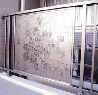 A piece of decorative perforated sheet is installed on the balcony railing.