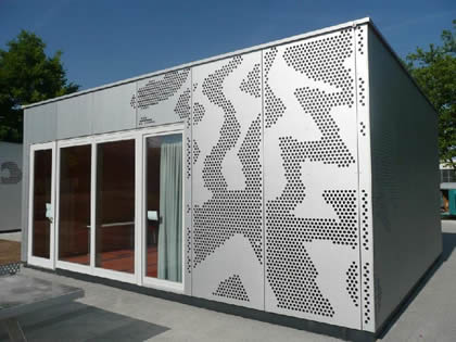 The wall of a restaurant is designed with the decorative perforated sheet.