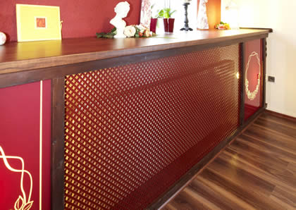 A red counter is cover by a piece of decorative perforated sheet.