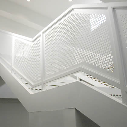 Mild carbon steel perforated sheet with white powder coated is installed on the balustrade railings.
